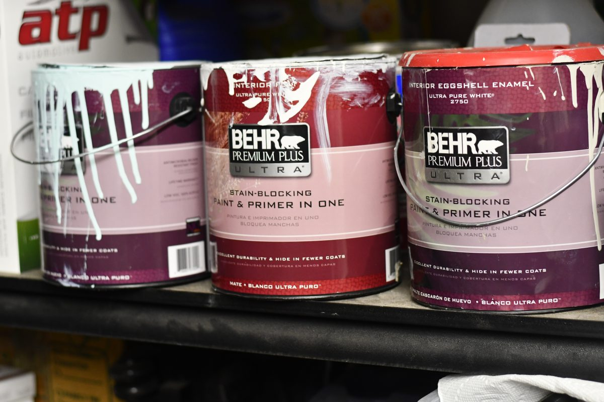 cans of paint on a shelf