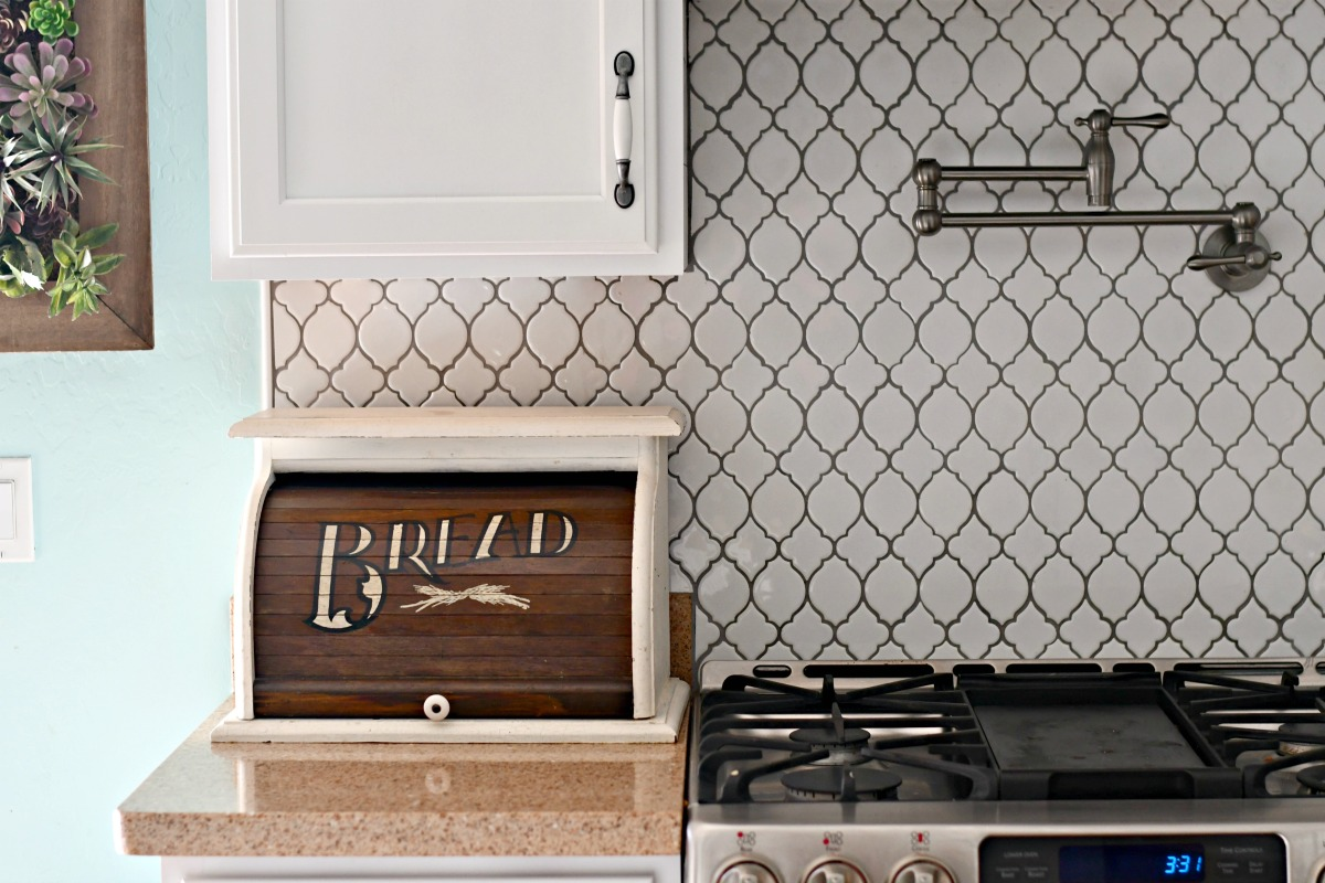 the bread box kitchen counter organizer closed and next to the stove