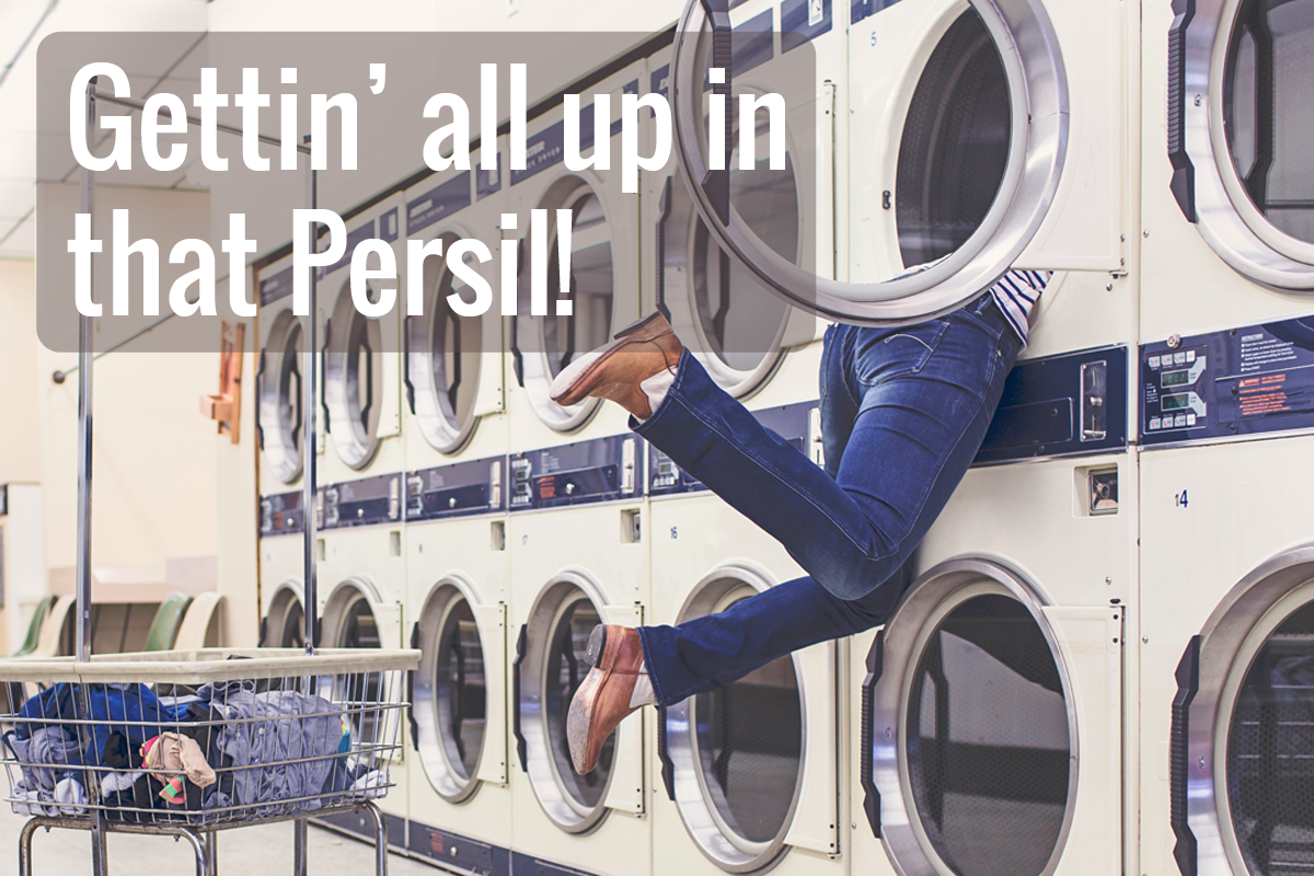 """woman hanging out of a washing machine in a laundromat with """"Gettin' all up in that Persil!"""""""