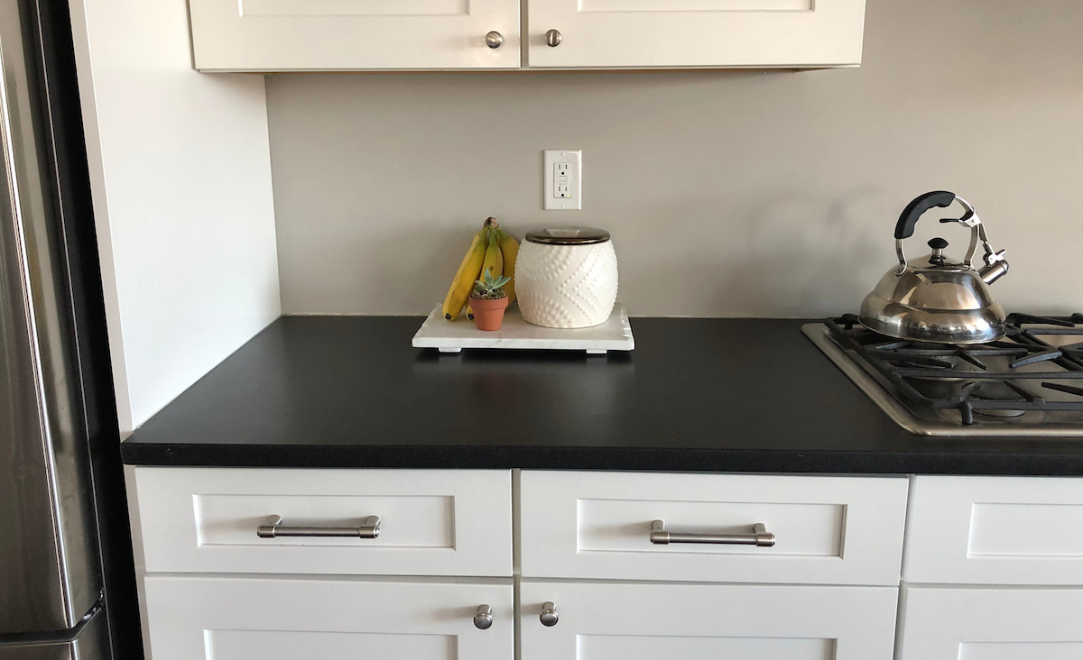 clean counter top with a bunch of bananas and a succulent on top