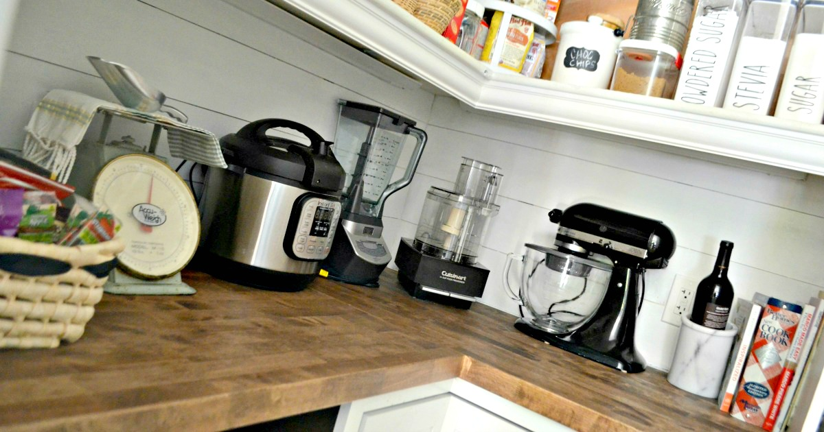 kitchen appliances on a pantry shelf