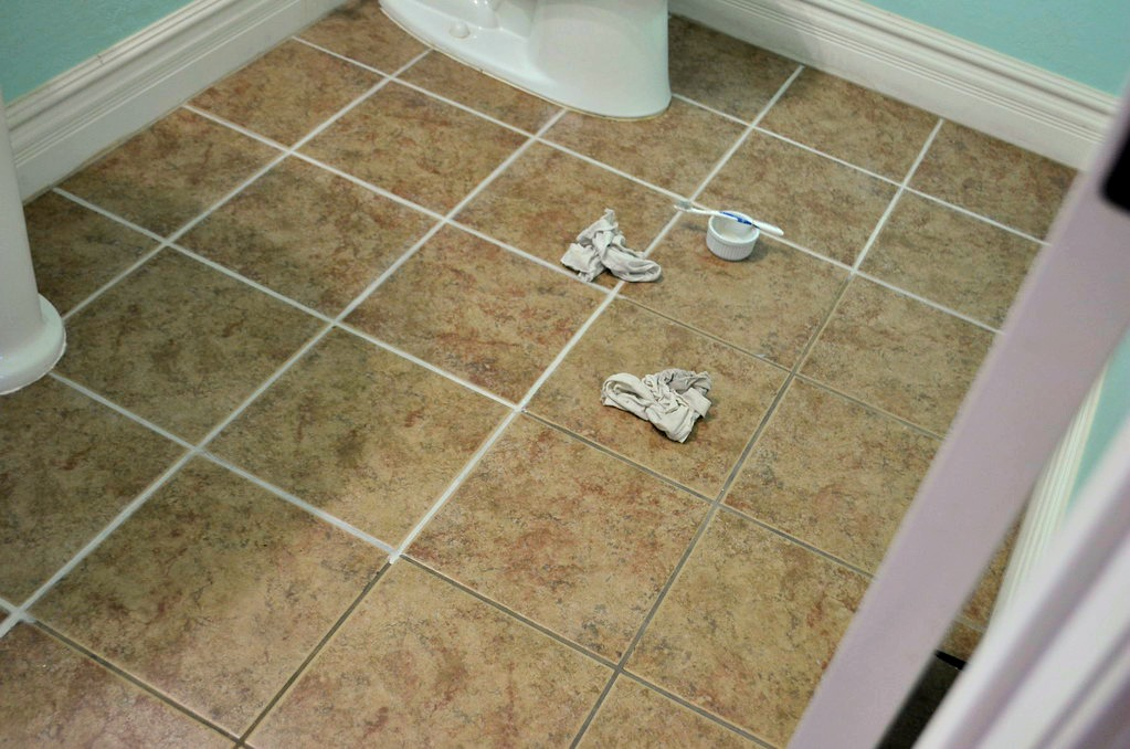 before and after comparison on the same bathroom floor