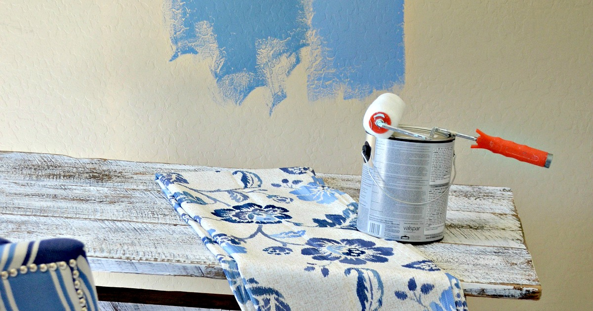 paint can and roller on a table