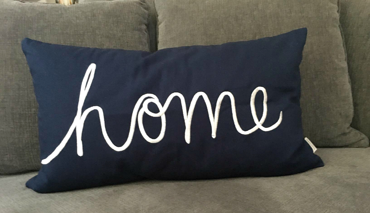 "Pillow that reads ""home"""