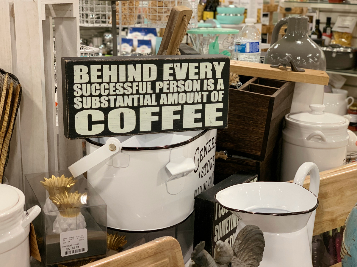 """TJ Maxx sign reading """"Behind every successful person is a substantial amount of coffee"""""""