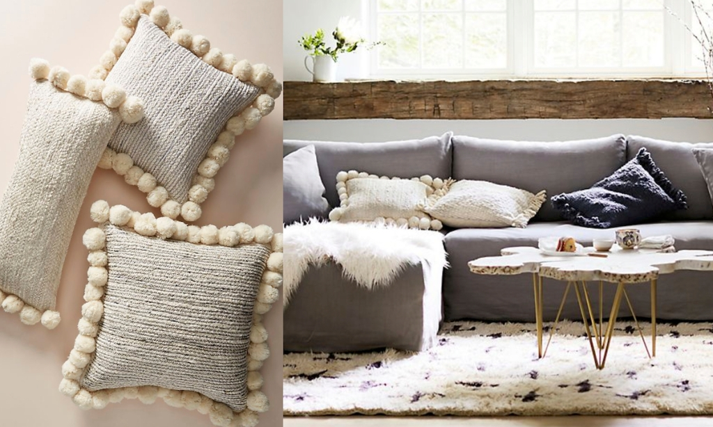 pom pom pillows on couch black and white jute