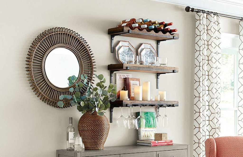 wood and iron shelves on wall next with mirror with other decor