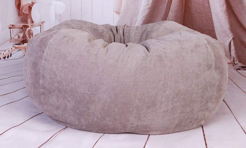 brown tan beige bean bag chair sitting in a pink studio