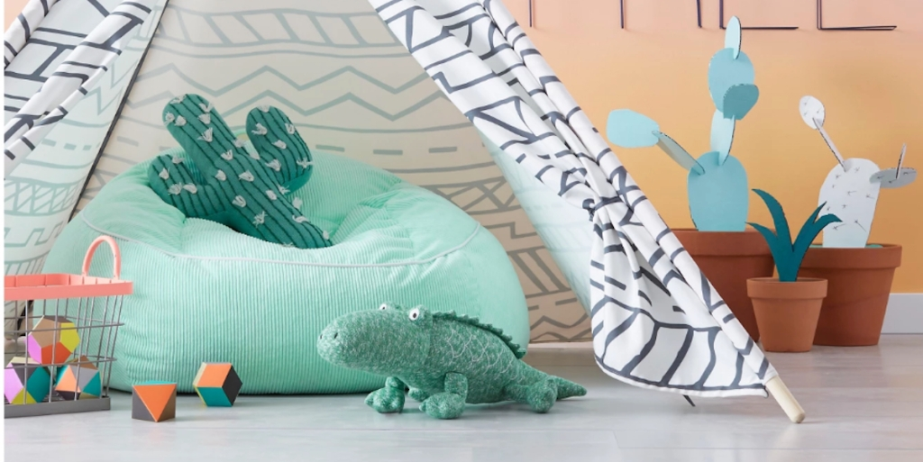 cactus shaped pillow on bean bag chair under teepee playroom