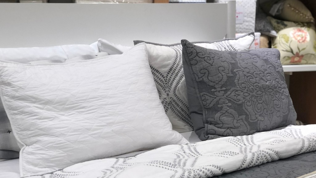bed bath and beyond showroom bed with decorative pillows
