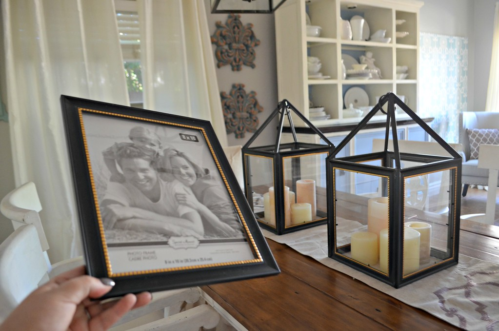 picture frame next to a lantern