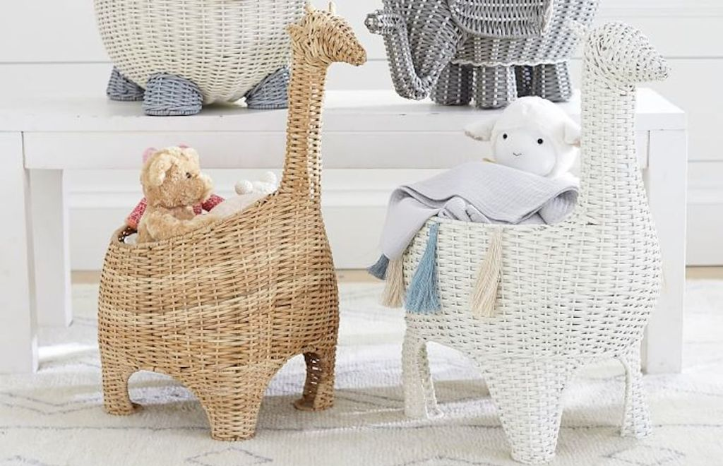 brown tan and white giraffe shaped wicker baskets on floor with stuffed animals inside