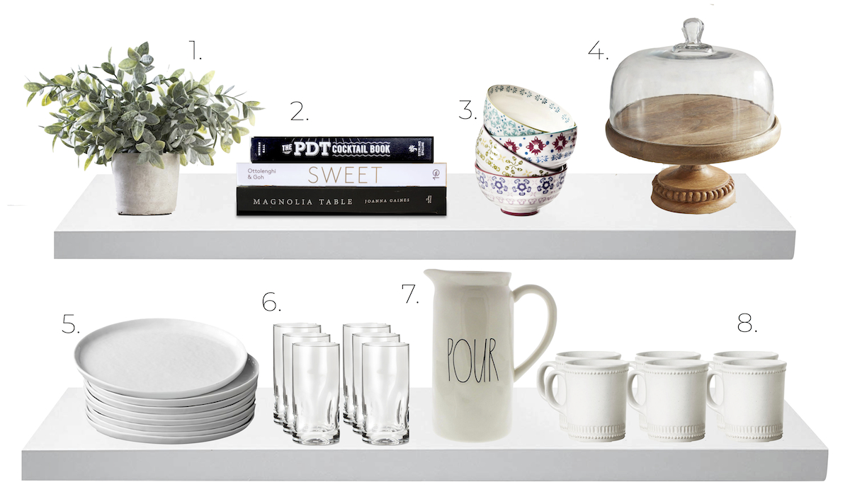 kitchen shelves with dishes, plants, books, bowls, plates, glasses, water pitcher, coffee mugs