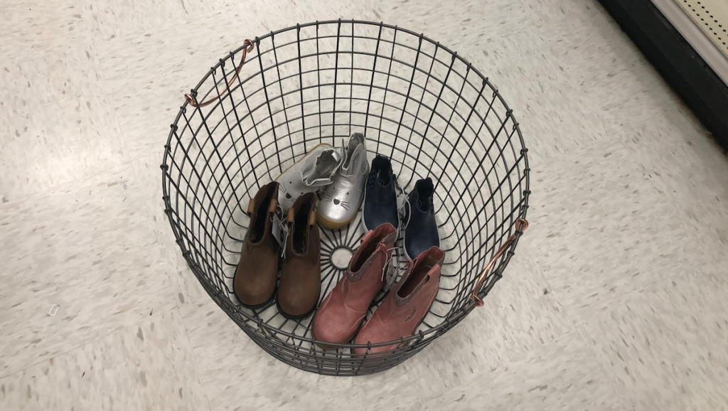large wire basket bin with shoes copper handles four pairs of kids shoes