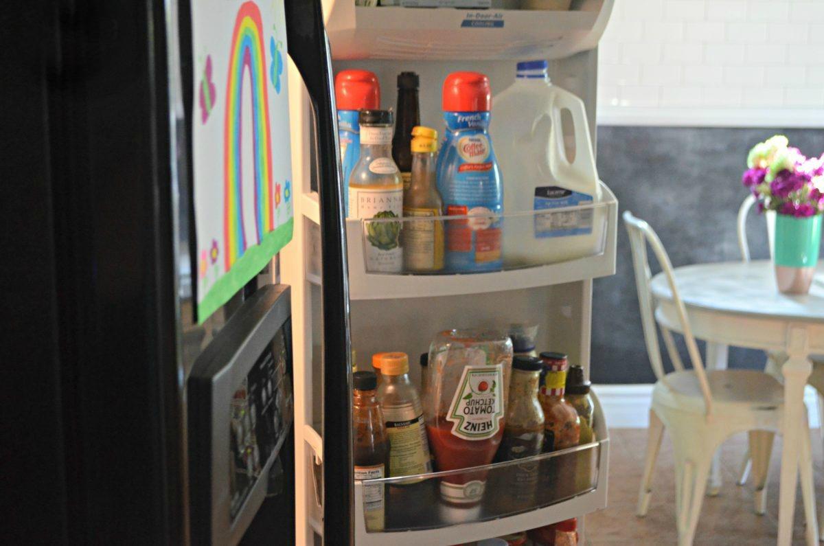 open refrigerator with condiments in the door