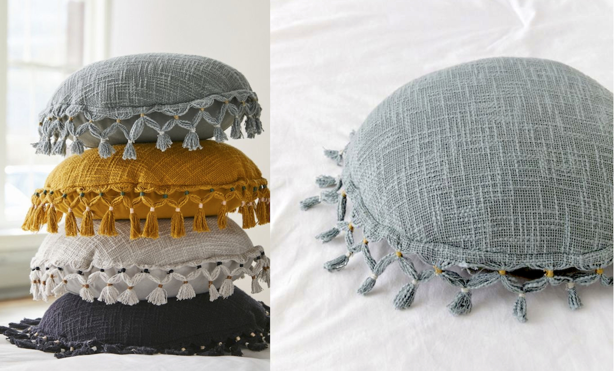 stack of round pillows in black, gray, ivory, cream, mustard, yellow, orange, teal, blue