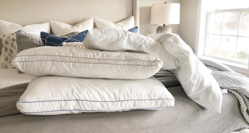 sleeping pillows without cover on bed
