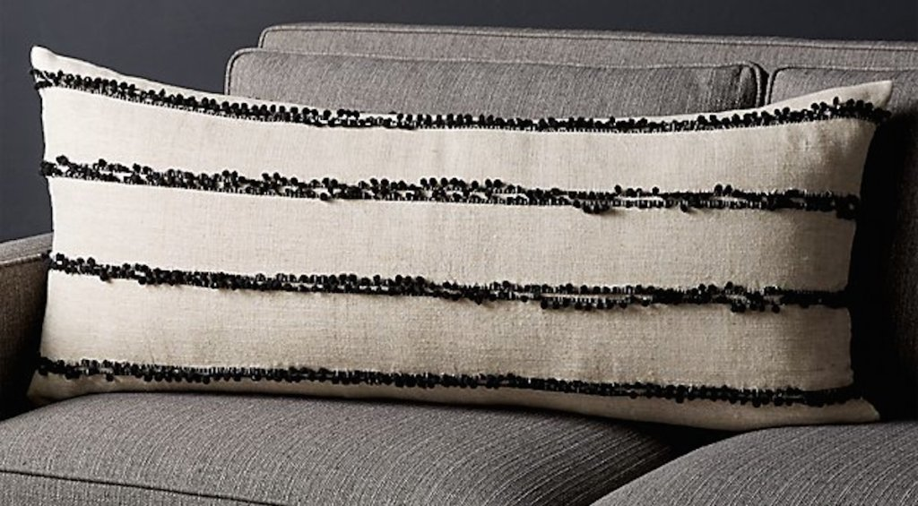 black and white stripe lumbar pillow on gray couch