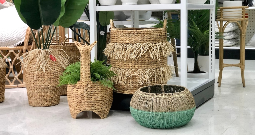 various wicker rattan seagrass fringe baskets sitting in a group