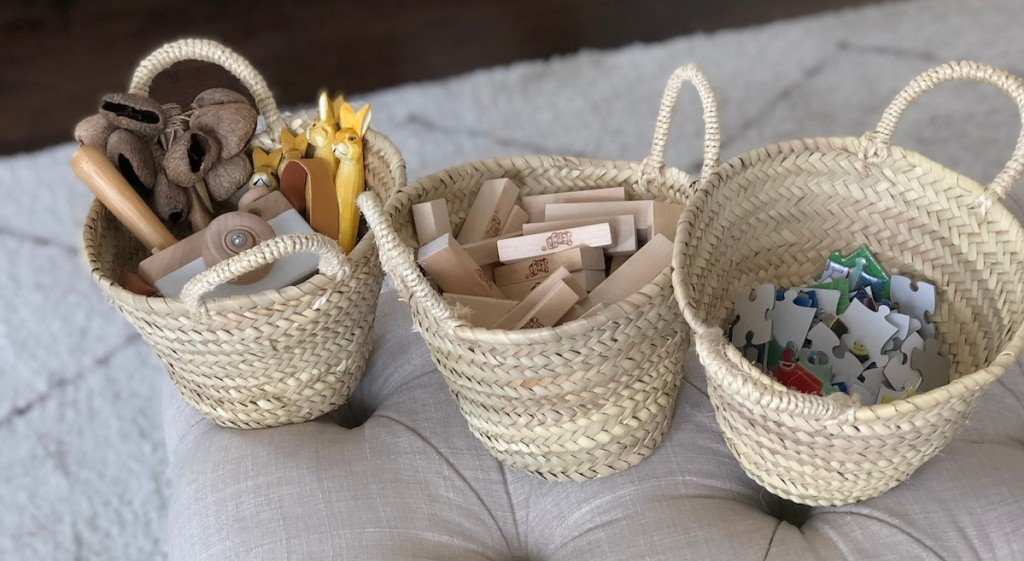 small toys puzzles and blocks in small seagrass baskets with handles