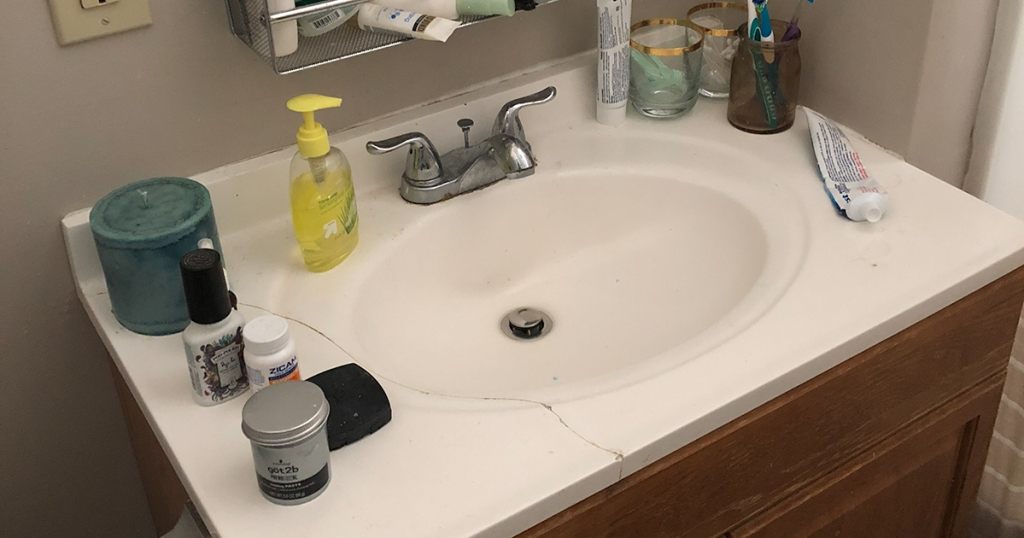 messy and cracked countertop sink