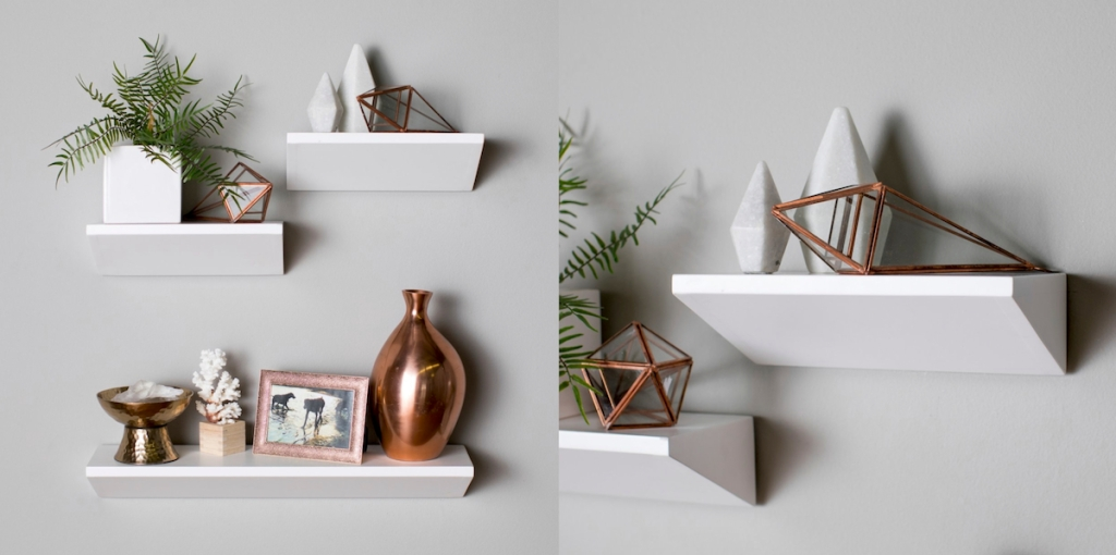 white shelves on wall with decor