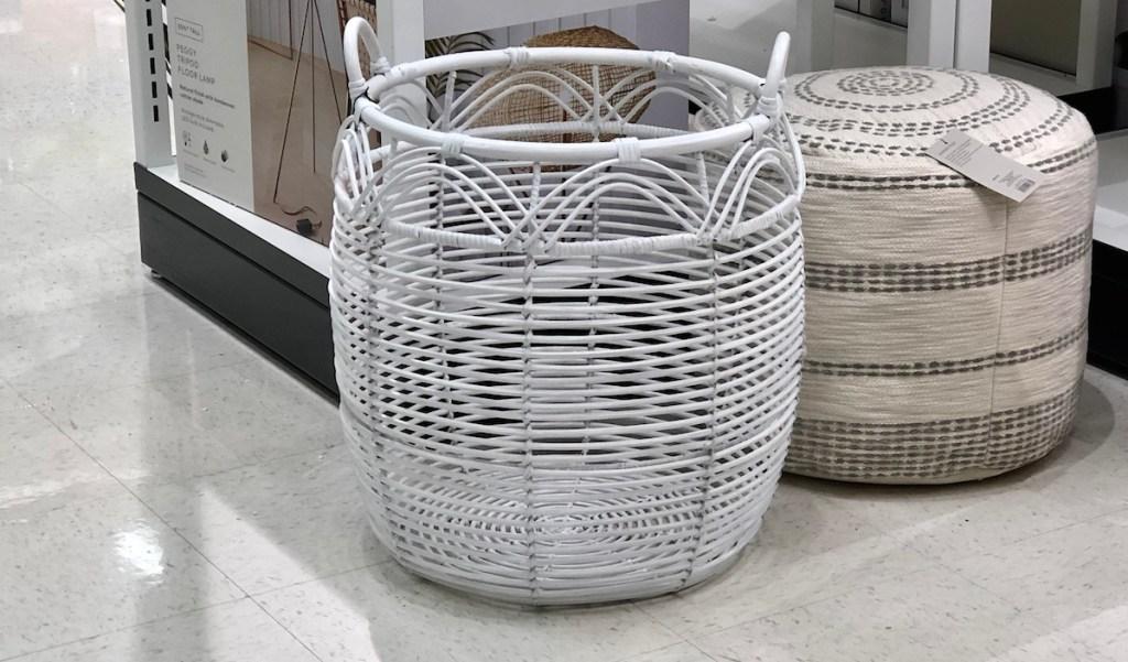 white rattan basket on floor