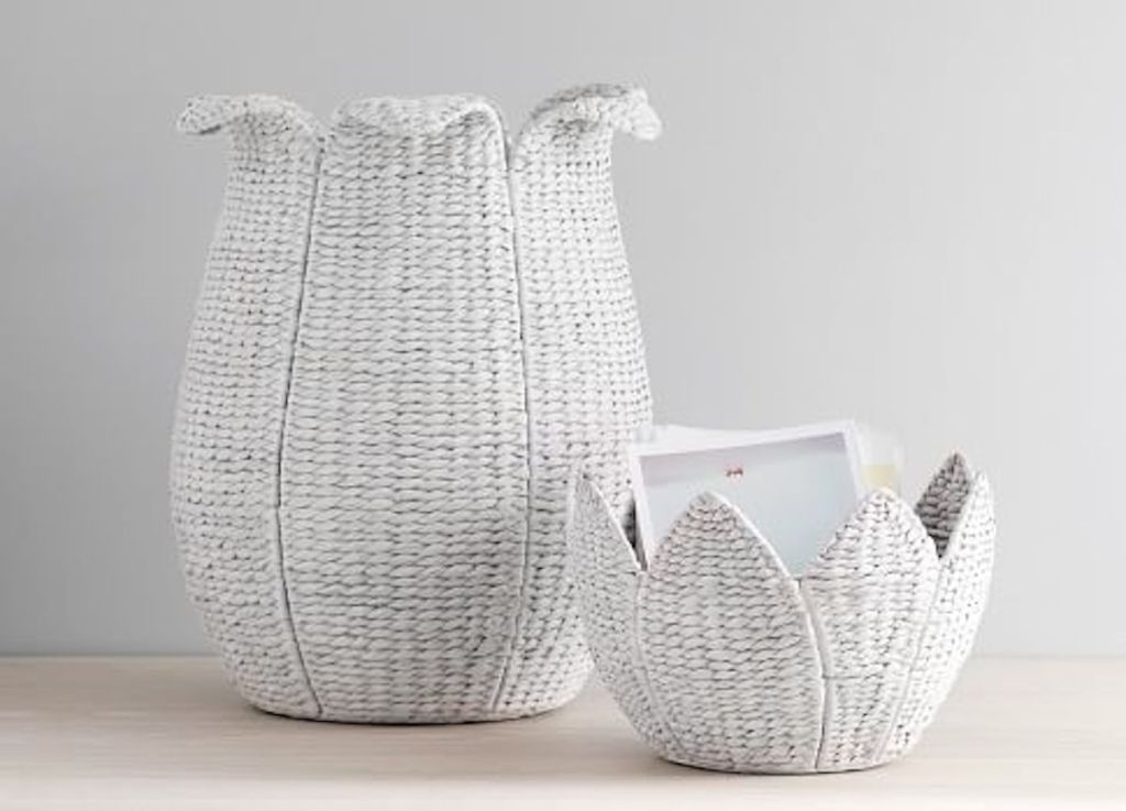 white washed woven flower baskets sitting next to each other on the floor