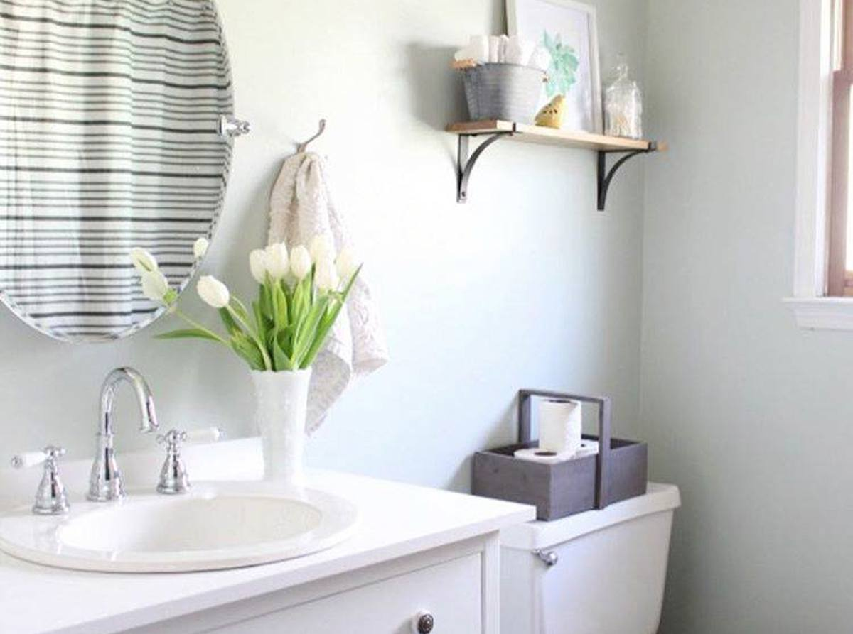 light and airy bathroom with fresh flowers on the sink