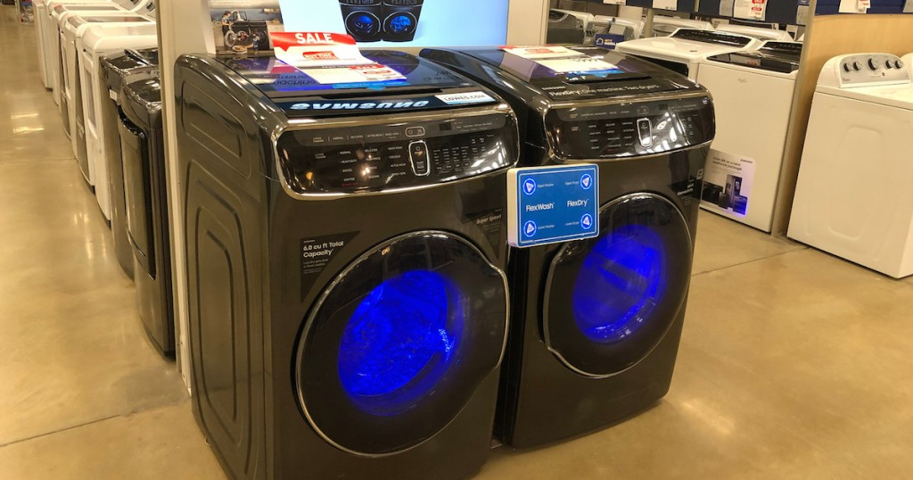 gray colored front loading washing machine and dryer with blue lights