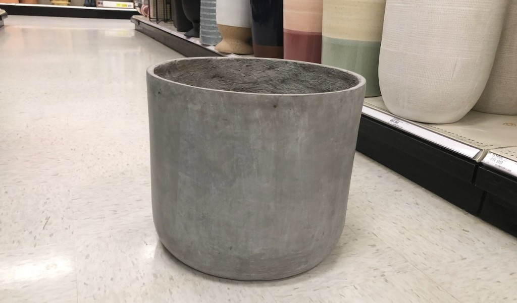large concrete planter sitting on floor