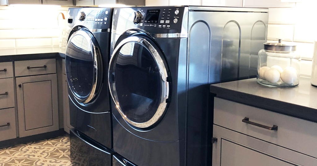 dark blue colored laundry room appliances with cabinets