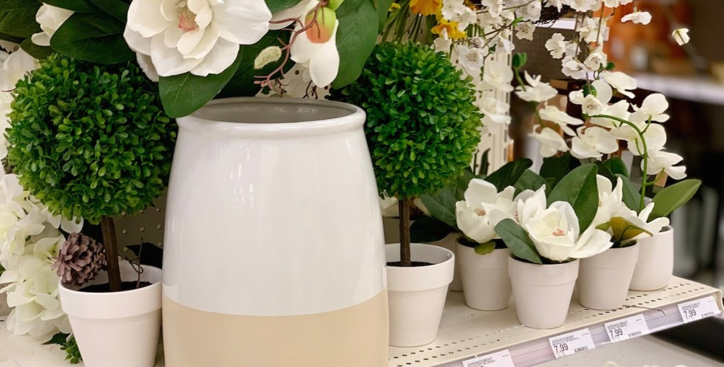faux white florals with assorted pots and planters on shelf