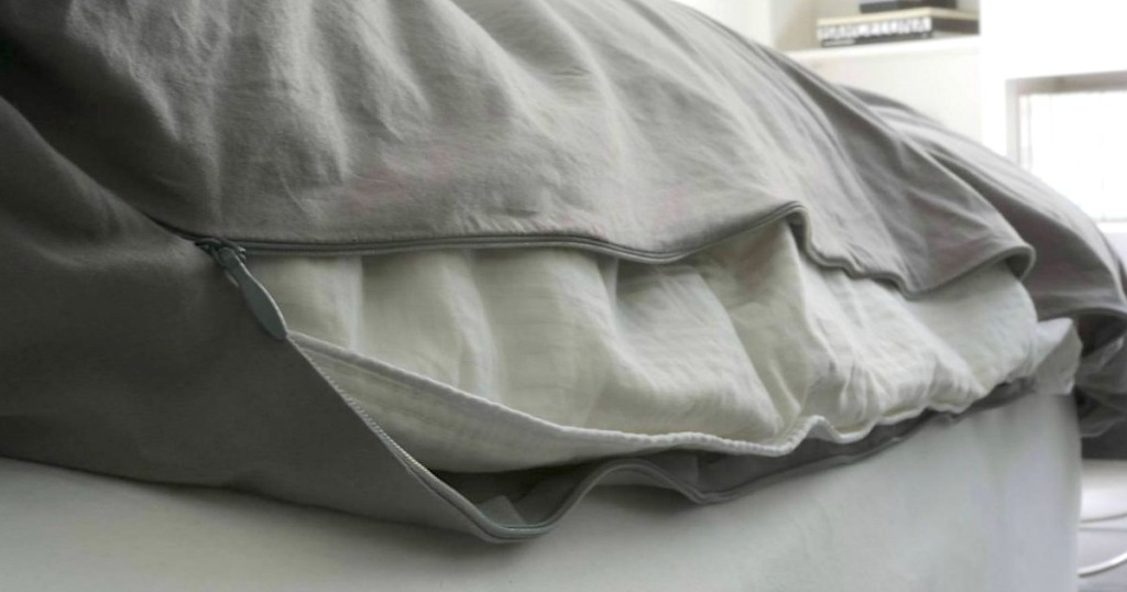 zipping up grey duvet cover insert