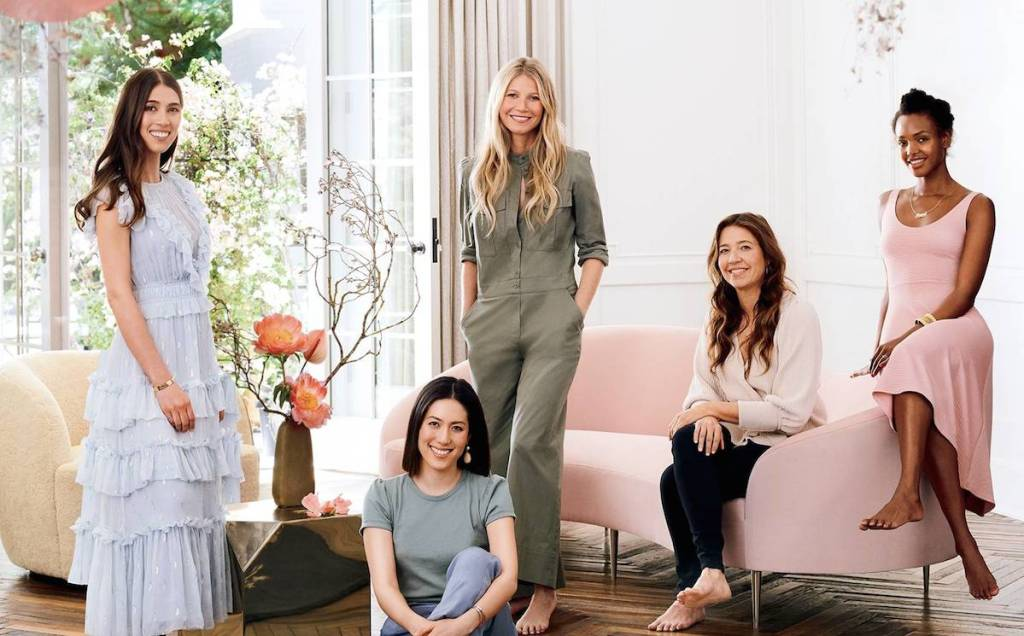 Gwyneth Paltrow standing in beautiful living room with other women