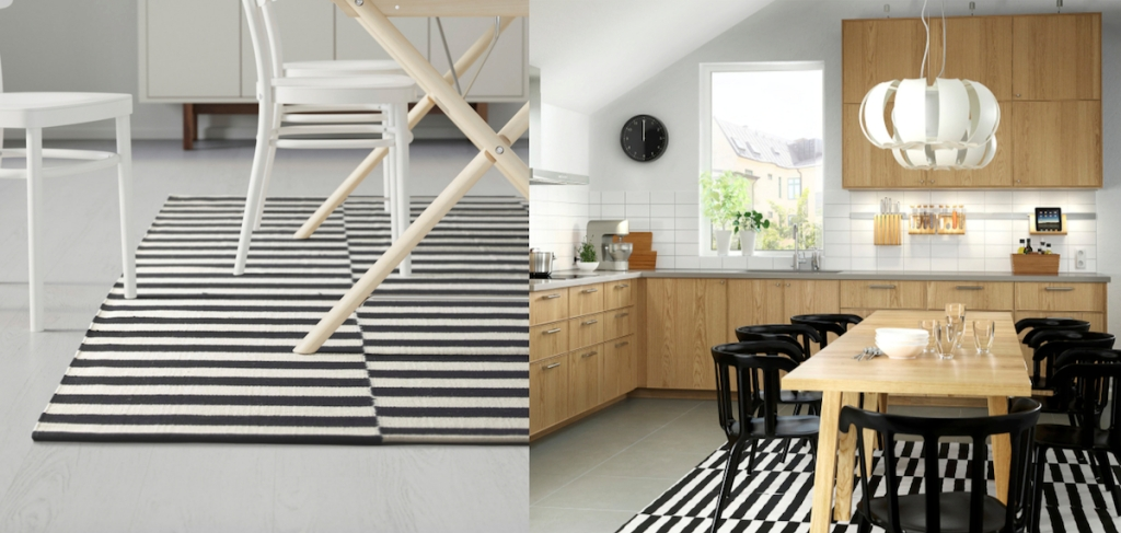 black and white stripe rug under modern wood table and chairs in kitchen