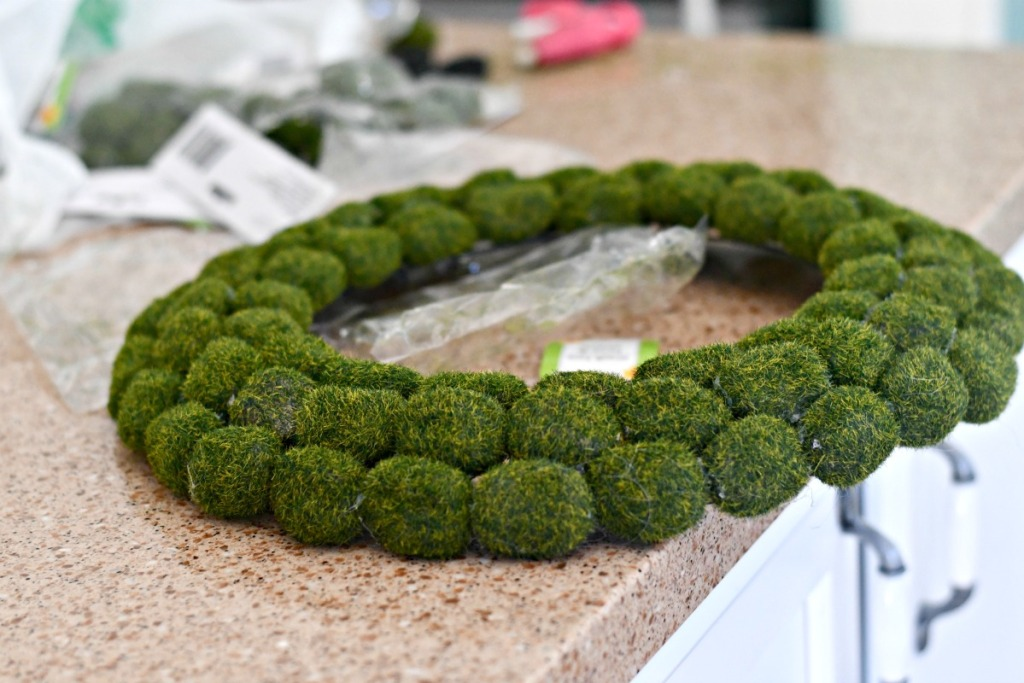 finished moss wreath on the counter