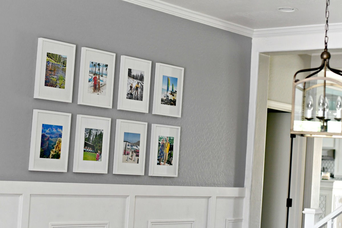 grid style gallery wall with white frames on a gray wall