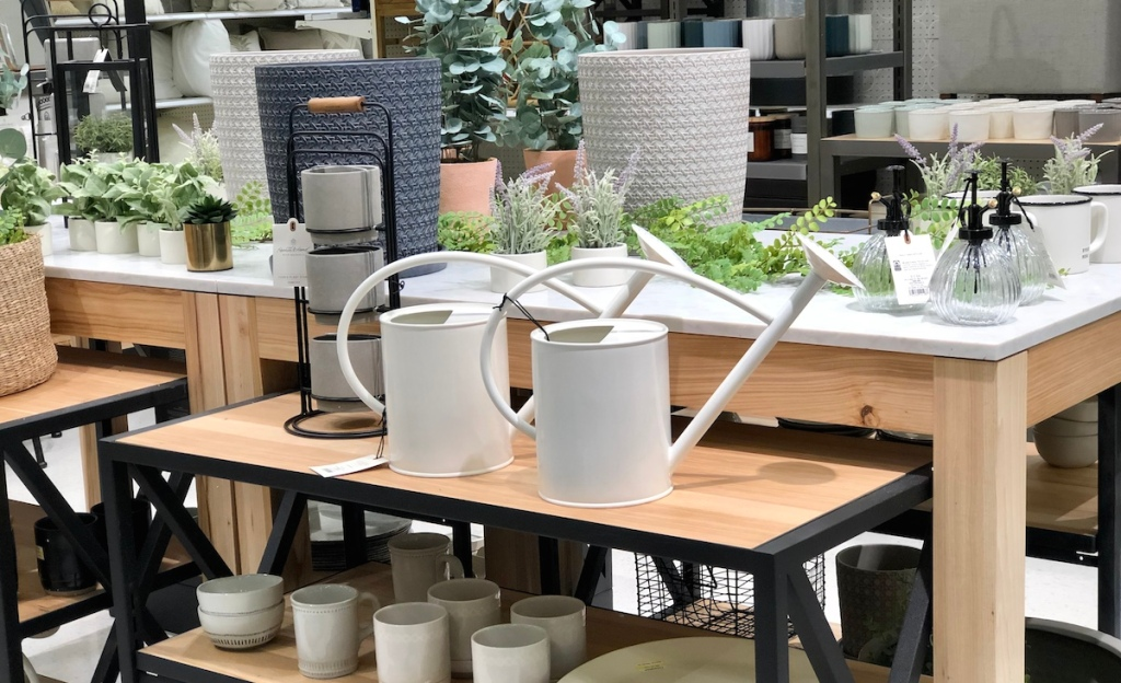 spring home decor essentials on wooden store shelves