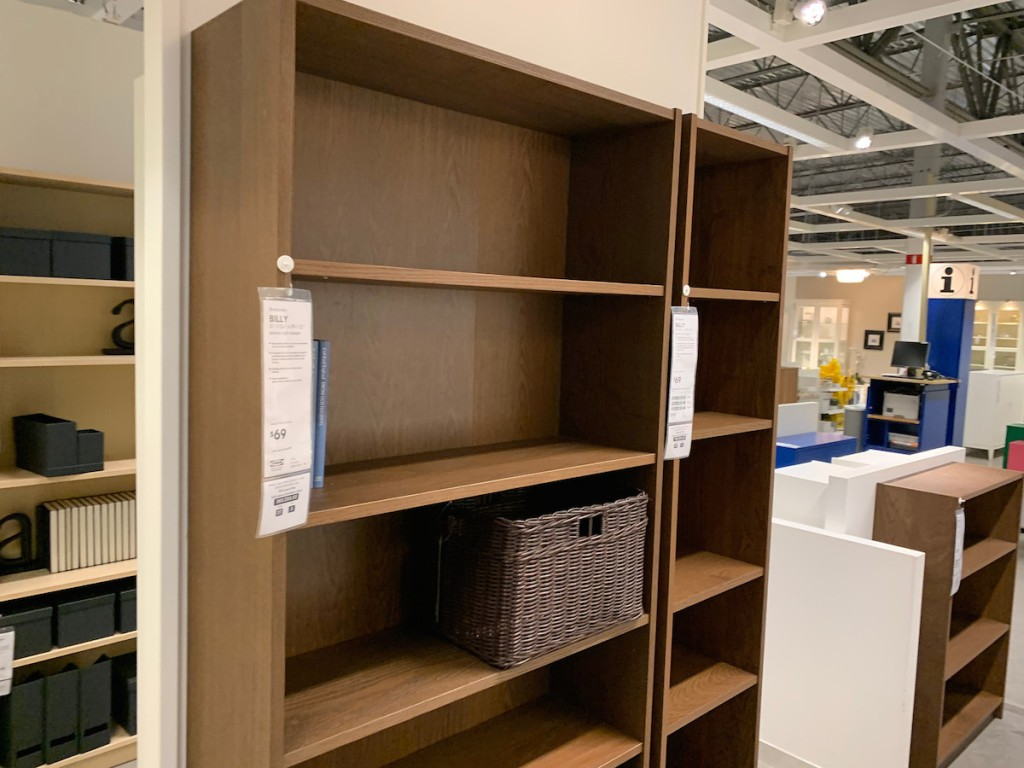 brown bookcases with one brown bin on it in store