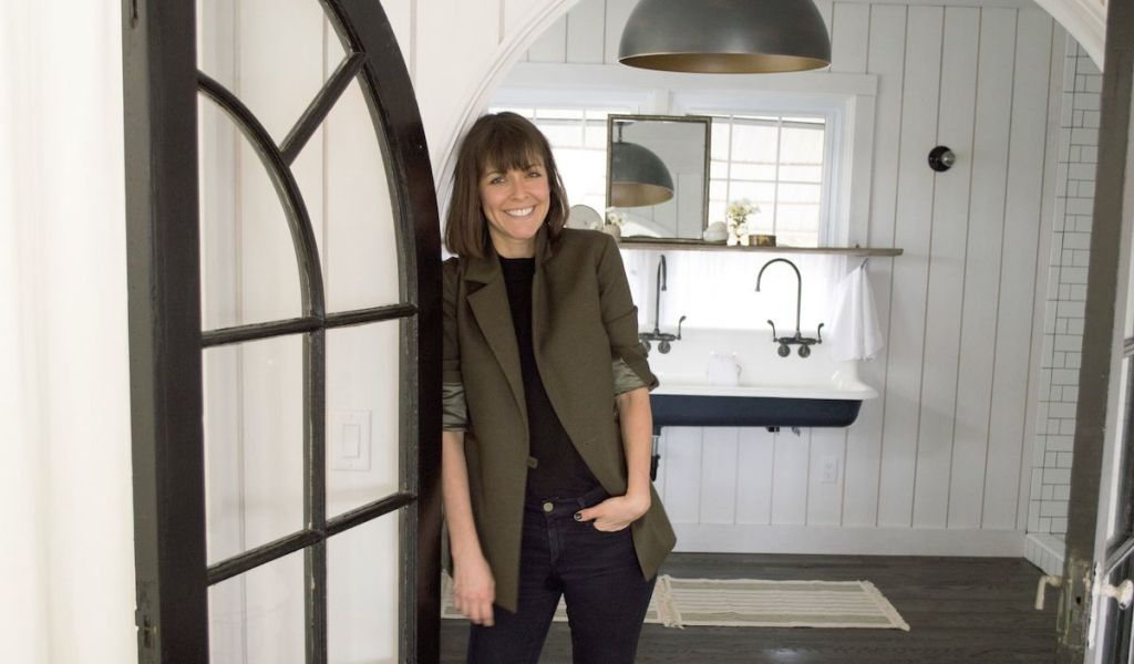leanne ford standing leaning on a doorway with sinks in the background
