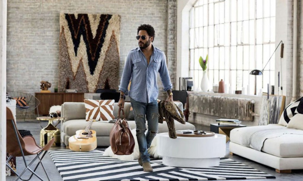 lenny kravitz walking in gorgeous well lit living room with furniture and decor