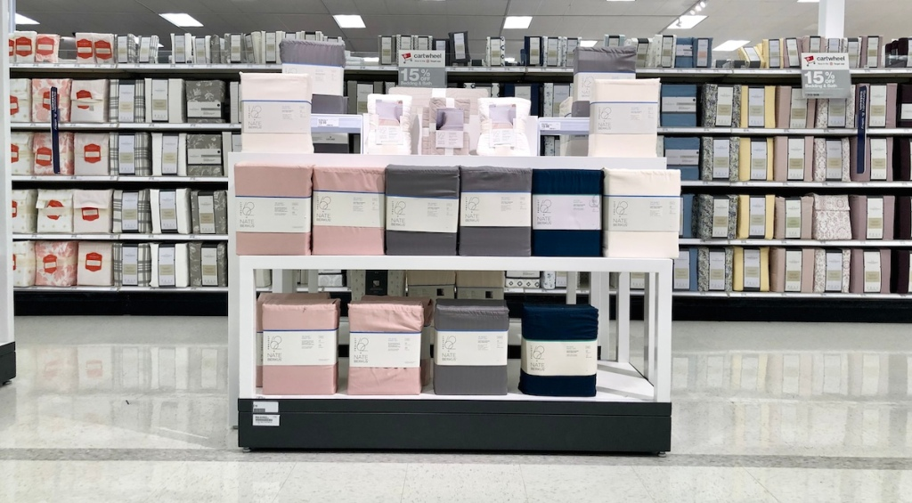 tons of different colored bedding lined up on store shelves
