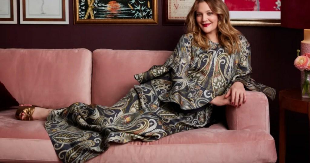 Drew Barrymore sitting on her velvet couch