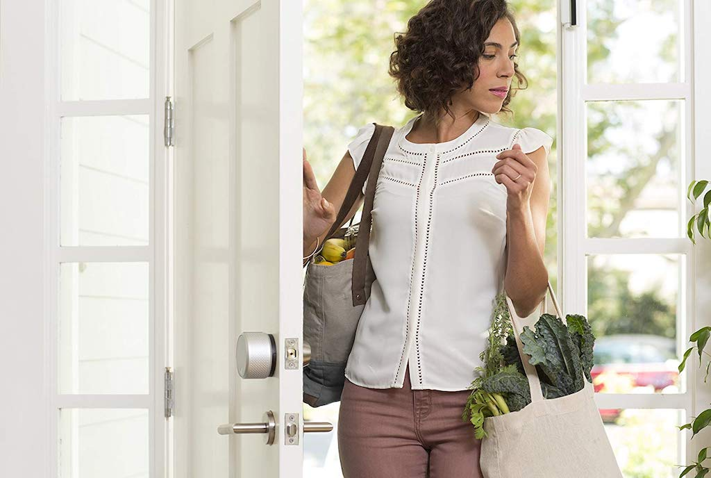 lady opening door with digital smart lock