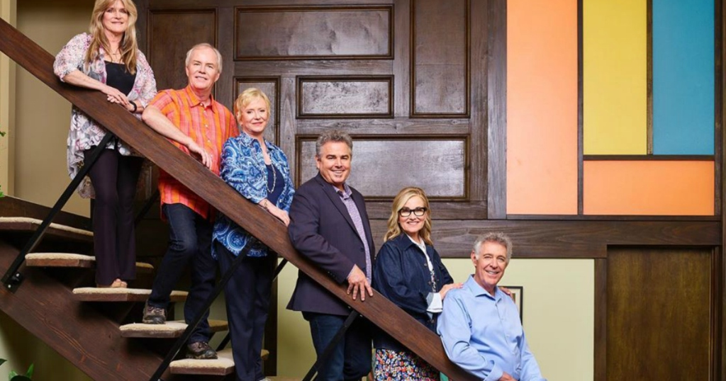 The Brady Bunch Crew standing on stairs
