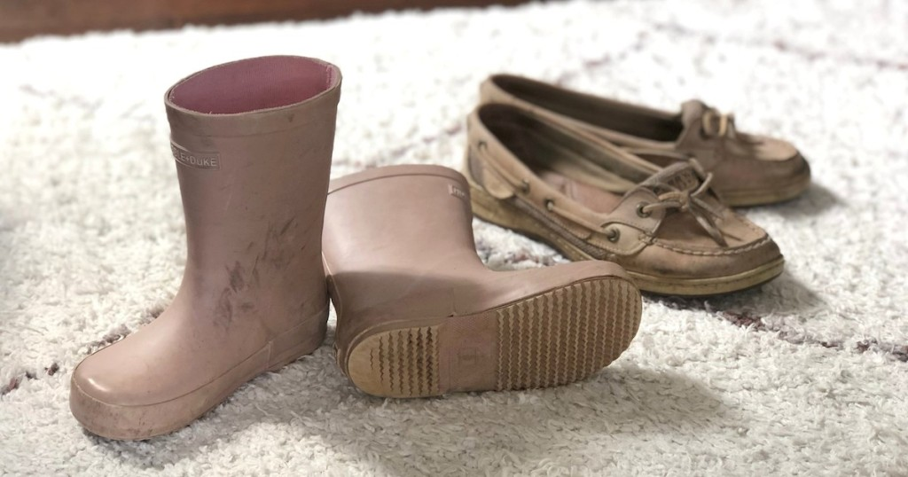 pink toddler boots and sperry boating shoes on white carpet