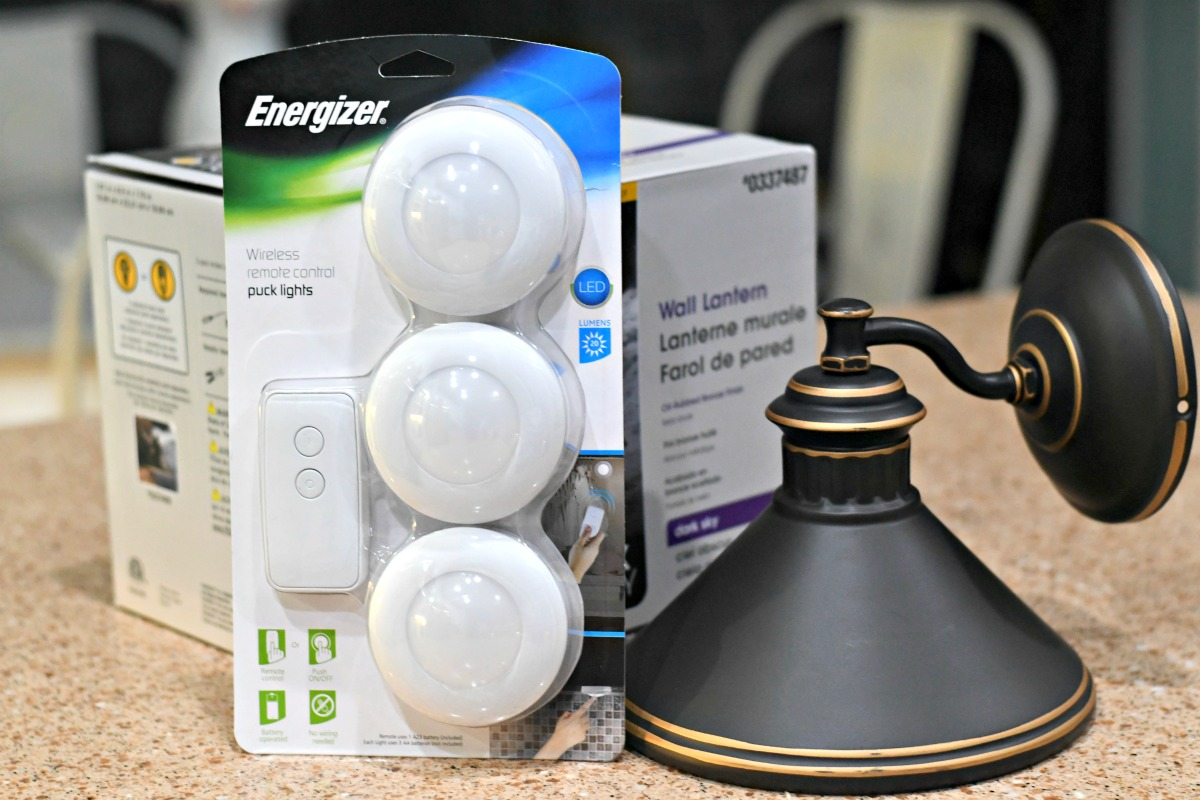 three-light puck pack next to a wall sconce