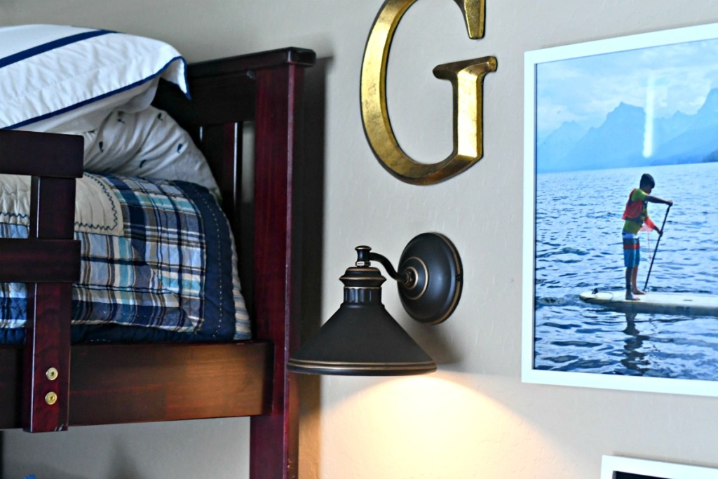 example of faux lighting with a sconce and puck light above a bed
