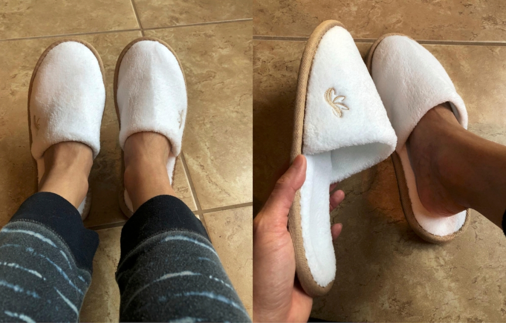 pair of feet wearing fuzzy white closed toe slippers